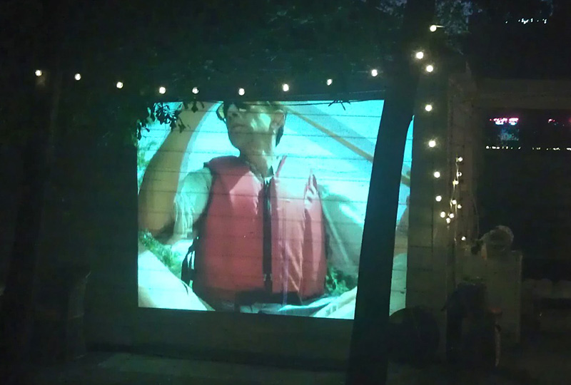 Video projection on exterior wall during the opening.